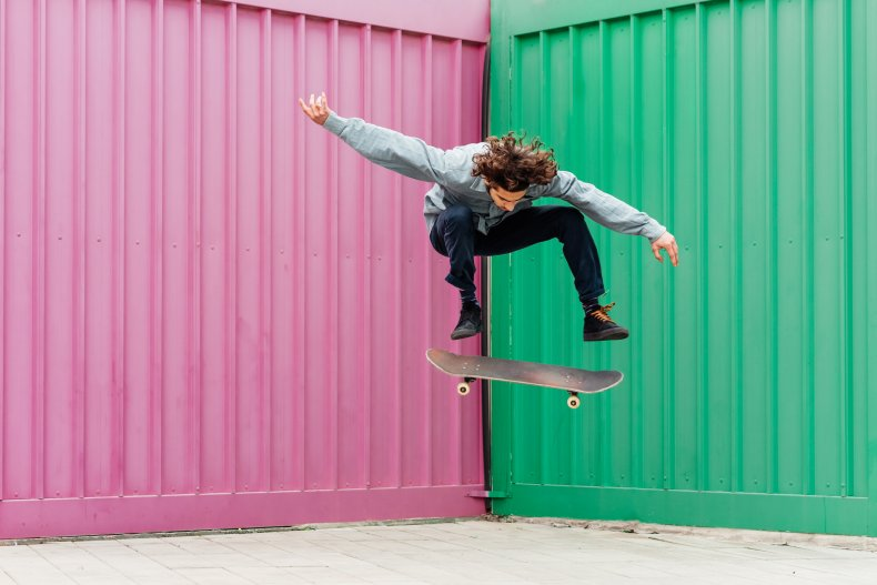 A skate boarder doing a trick