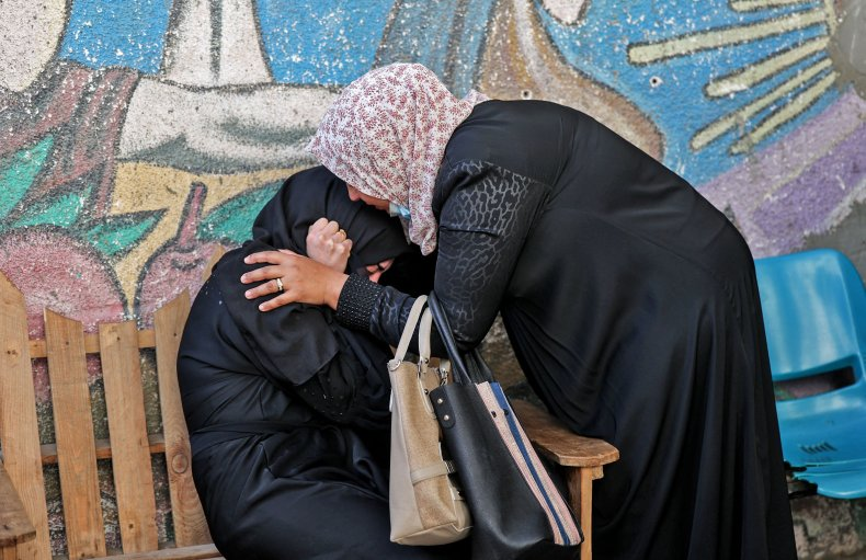 Palestinians mourn relatives dead by Israeli airstrikes