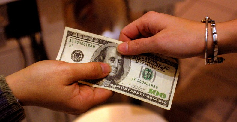 A Shopper Pays with a $100 Bill