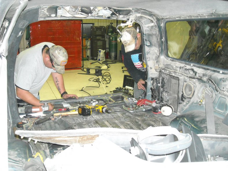 Military operators hollowing out vehicle rear