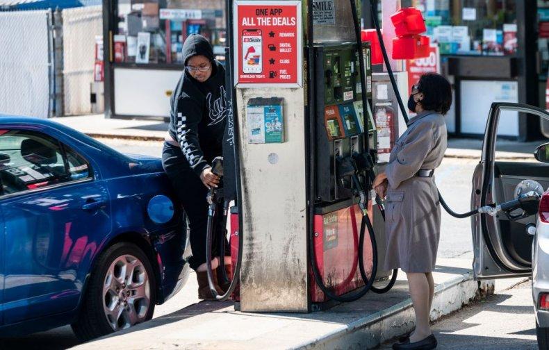 Motorists fill their cars in Arlington, Virginia