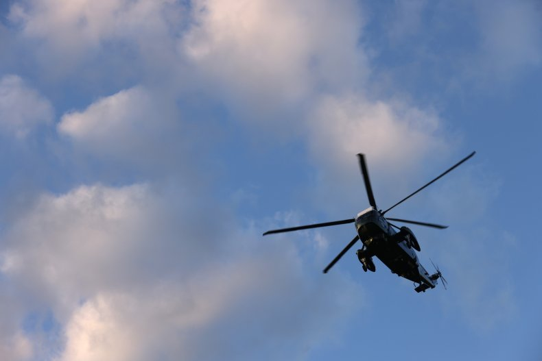 A helicopter circling in the sky.