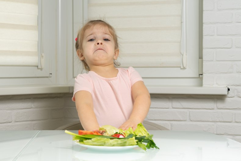 fussy child with vegetables