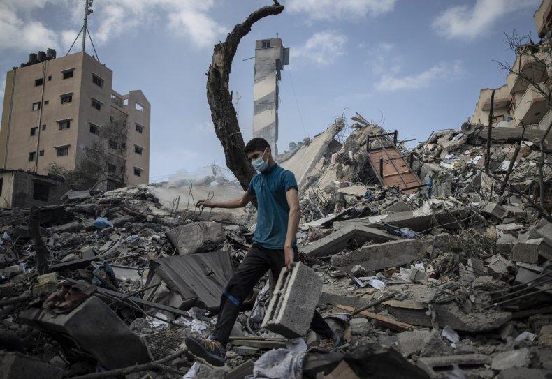 Palestinian Man inspects damage post airstrike