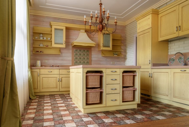 Stock image of a yellow kitchen