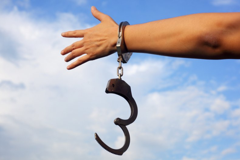 A hand freed from handcuffs