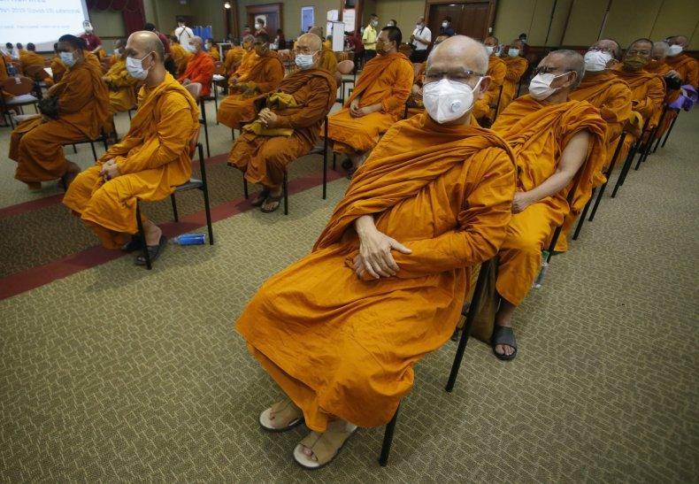 Buddhist Monks Wait for Vaccination