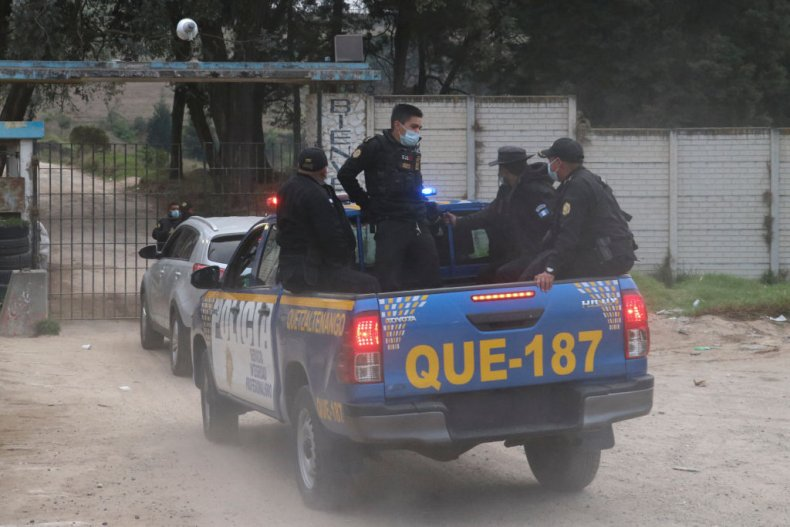 Police officers enter the prison