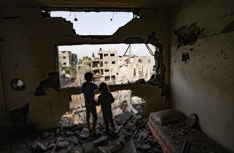Palestinian children in their bombed home Gaza