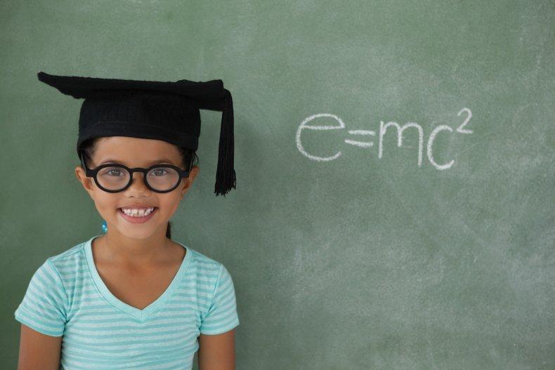 Little girl wearing a graduation cap