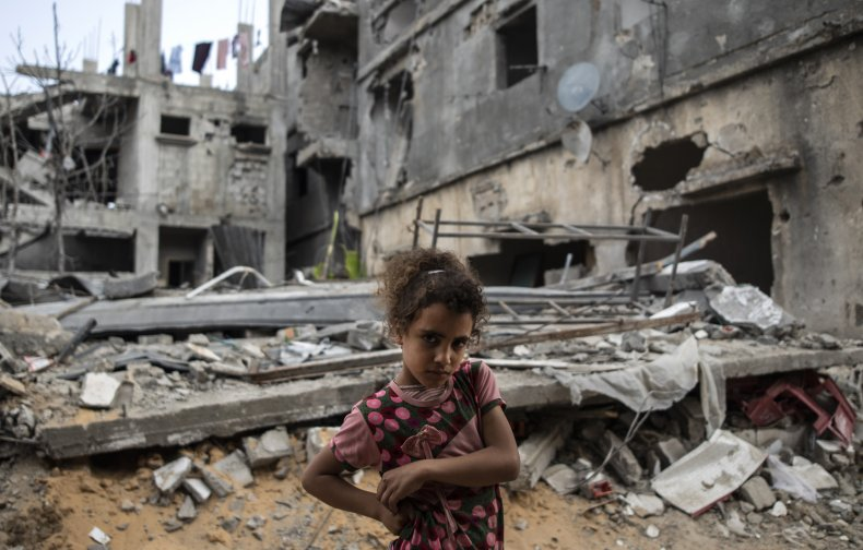 Girl In Front Of Crumbled Home, Israel-Palestine