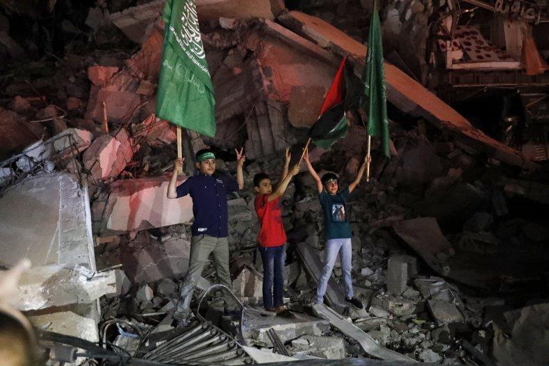 palestinian children wave flags