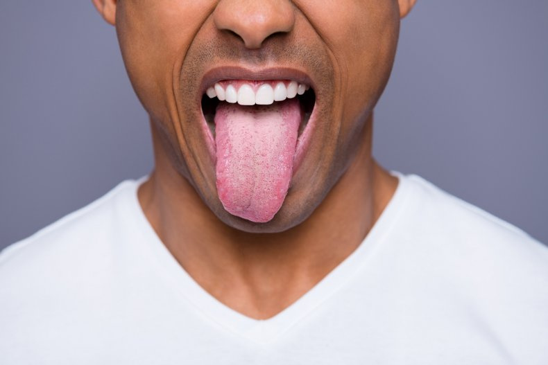 A man sticking out his tongue