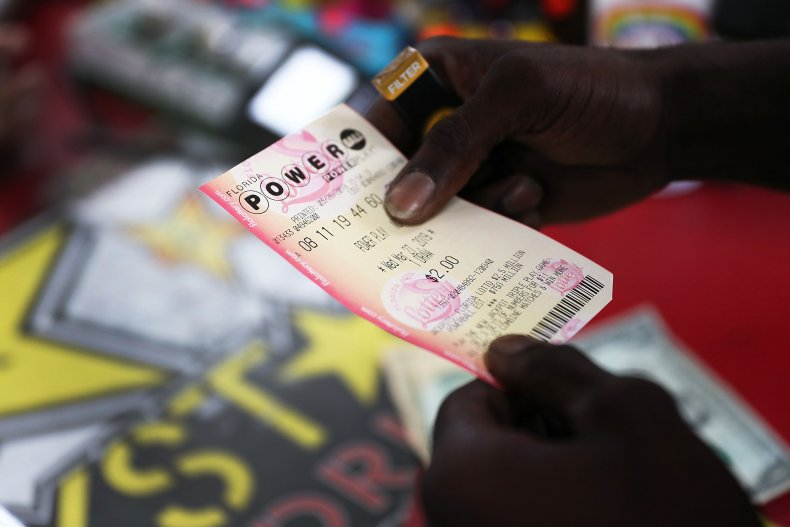 Man holds a Powerball ticket