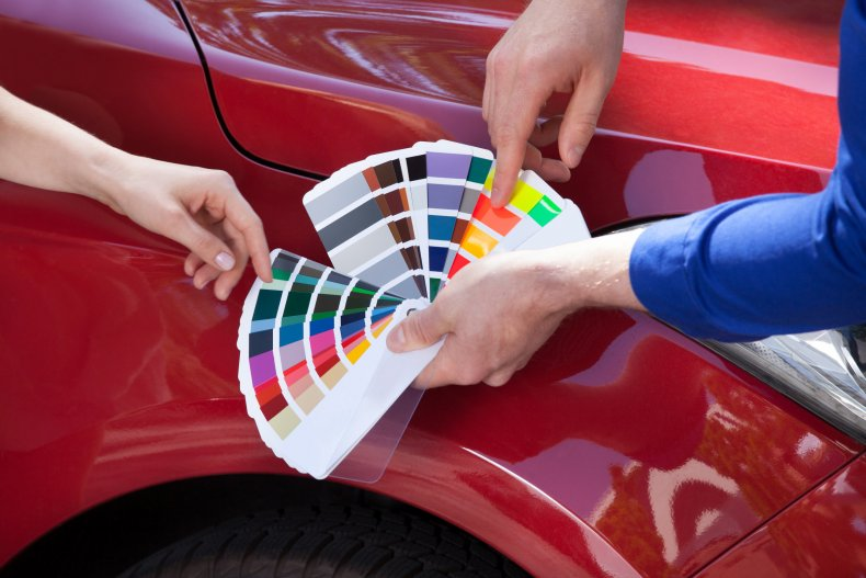 Color wheel against a car.