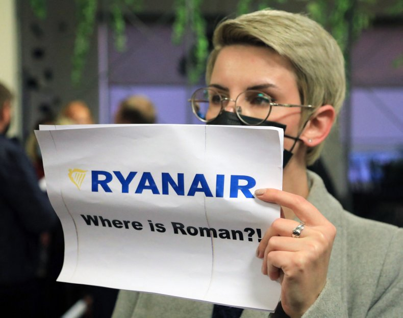 """Protester holds """"Where is Roman?"""" sign"""