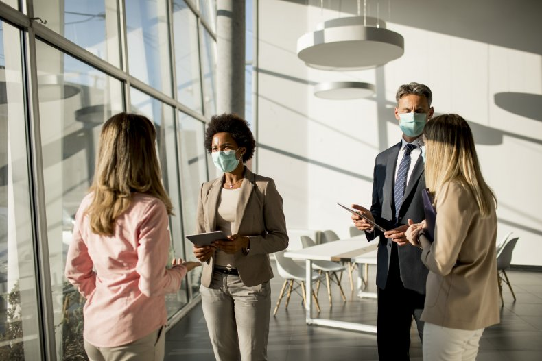 Employees talking in face masks