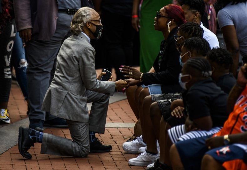 Rev. Al Sharpton speaks to Bridgette Floyd