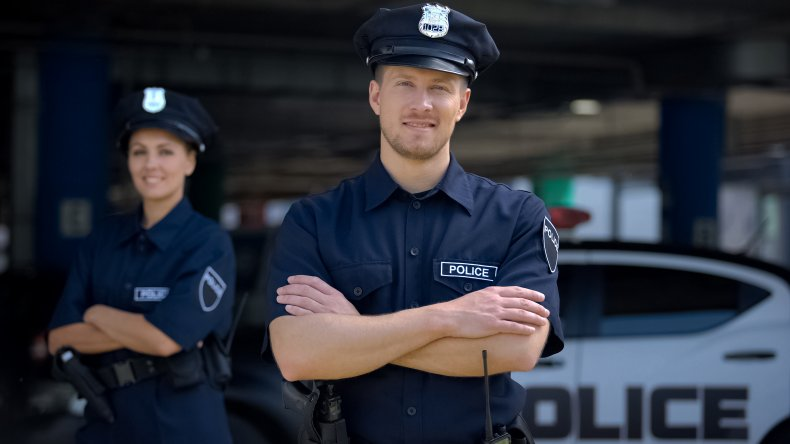 A police officer smiling