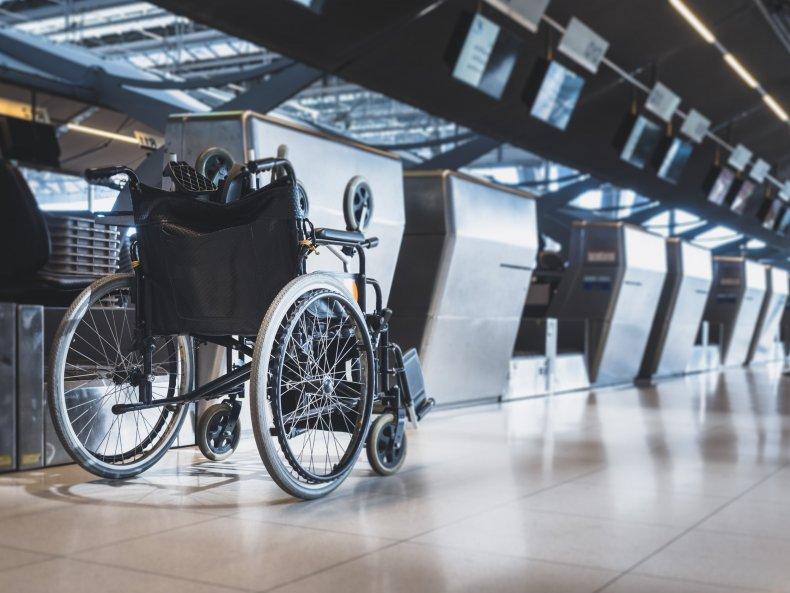 A wheelchair in an airport.