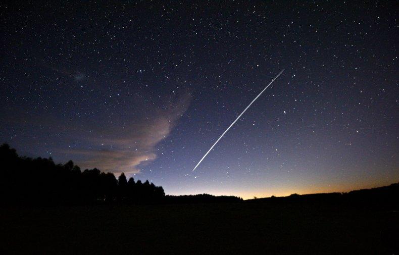 spacex starlink satellites strange line sky, getty