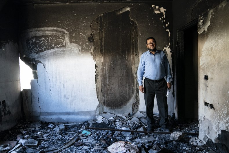 Man Standing in Gaza City Carnage