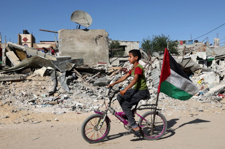 Palestinian Child Rides Bicycle Amid Ruins