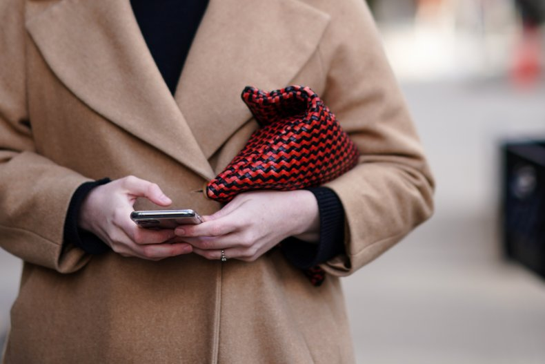 A woman holds a cellphone