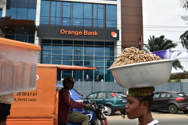 People walks past the Orange Bank