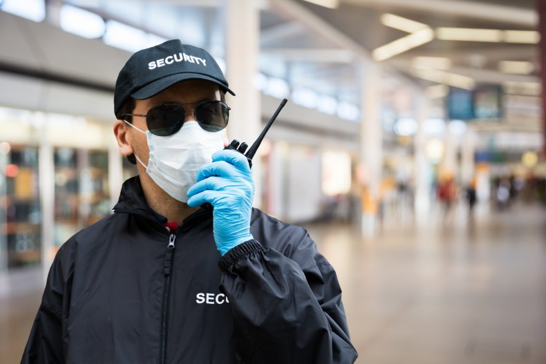 Airport security guard in a face mask