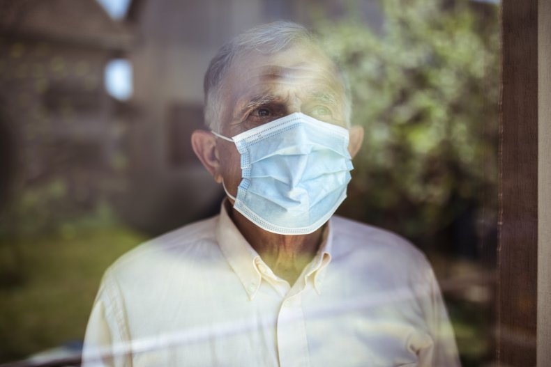 old man wearing a mask