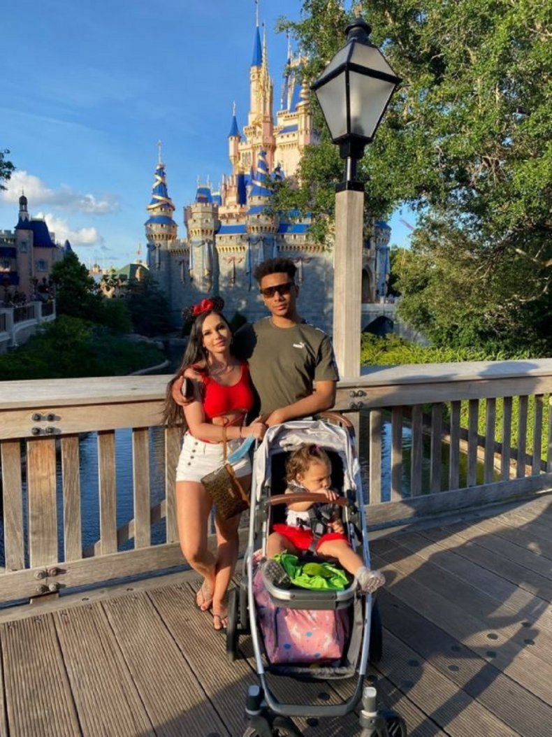 Amanda DiMeo, with her husband and daughter