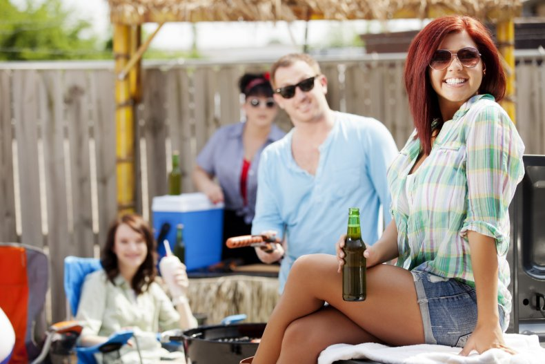 Stock image of friends at a BBQ