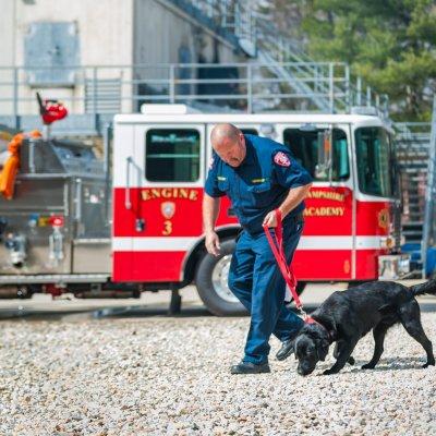 John Tadlock and Sheldon the dog working