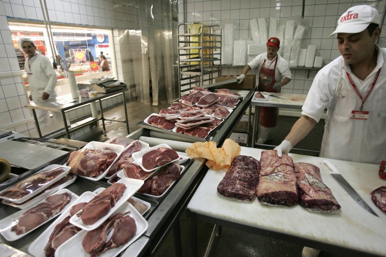 JBS employees prepare beef