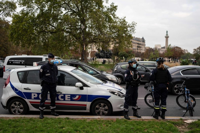 Paris police officers stand during protest