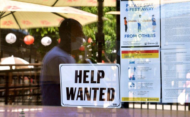 California man walks past help wanted sign