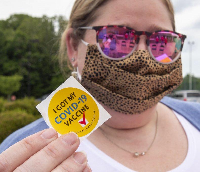 """Woman Shows Off """"COVID-19 Vaccine"""" Sticker"""