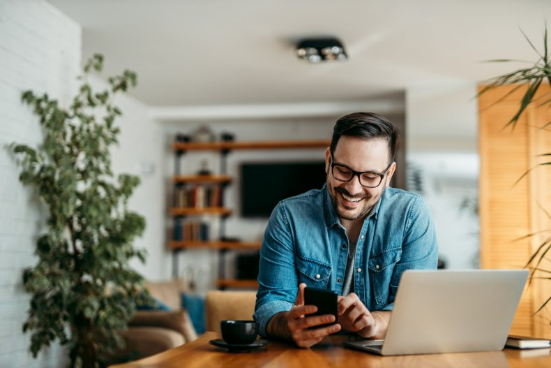 Man smiling with phone