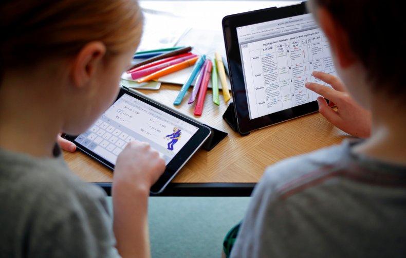 Children use iPads