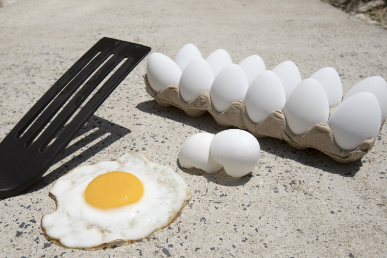 Stock image of eggs frying on sidewalk