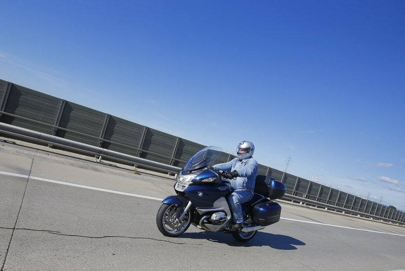 A man rides a motorcycle in Austria.