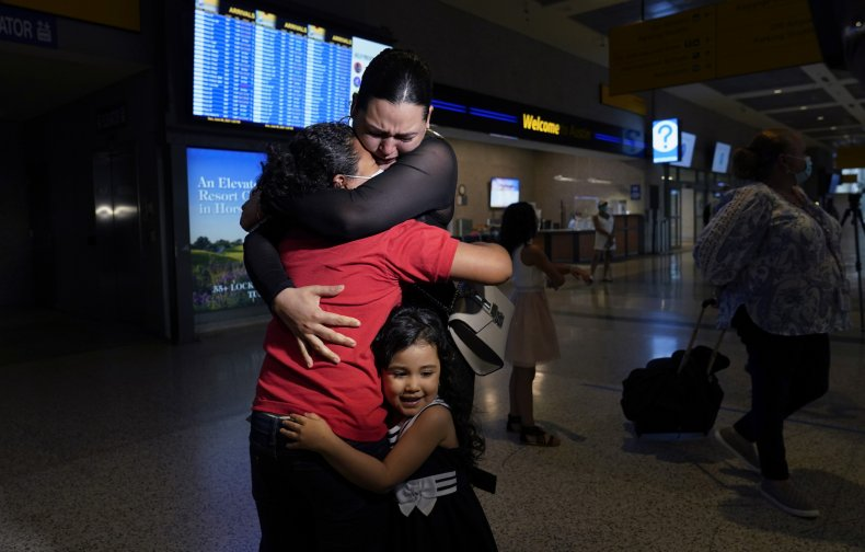 Mother and Daughter Embracing After Separation