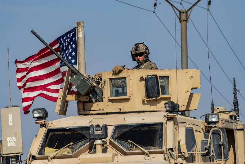 Soldier sits atop a U.S. military vehicle