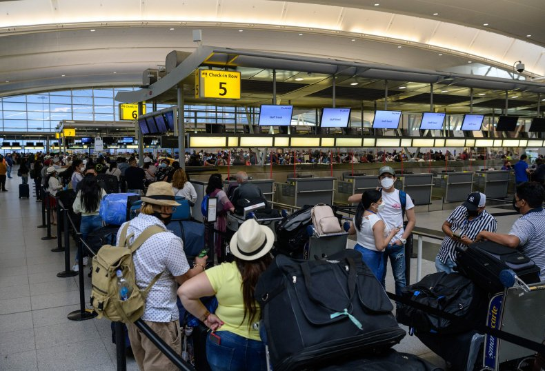 Travelers at JFK airport, NYC in 2021.