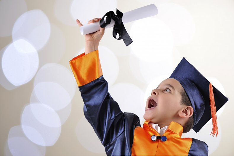 Boy on graduation wearing gown and cap