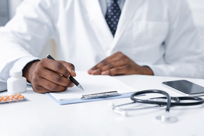 A doctor at a desk