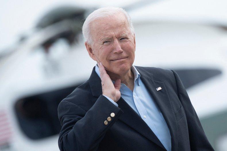 Joe Biden wipes his neck