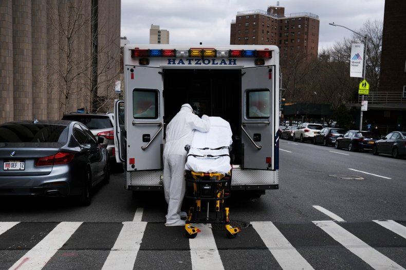 Ambulance driver cleans gurney