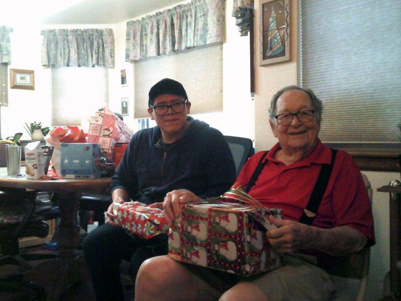 Kenneth and John celebrating Christmas together
